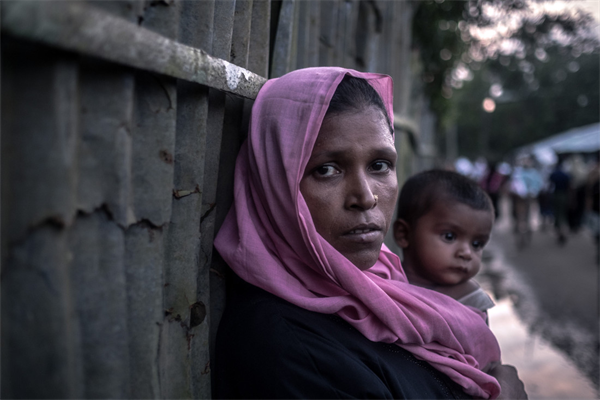 170930_OGB_Razida, 35, carries her ten month old son Anisul through Unchiprang Camp in Bangladesh.jpg