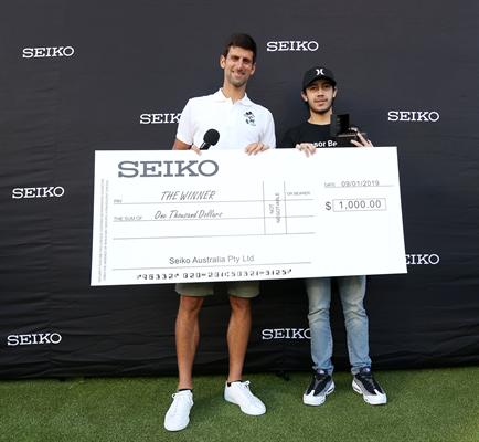 Novak Djokovic presents winner, Javier Pineros, of SEIKO Australia VR computer game featuring an avatar of Novak resized..jpg