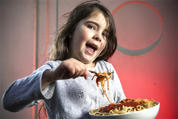 Five-year old Morrissey with Coles Mum's Sause which raises funds for sick children across Australia.jpg