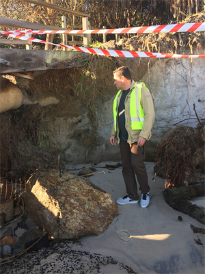 Photo 3 - Group Mgr Operations Steve Bennett inspecting the erosion under the beach access stairway.jpg