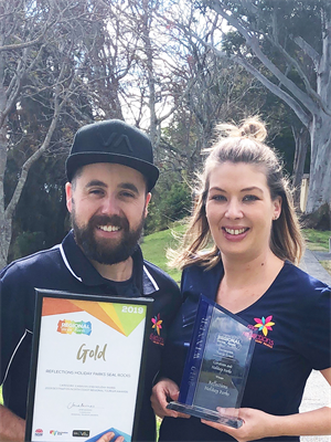 Reflections Seal Rocks Managers Justine and Eddy Syme celebrate their park's Gold Award at the North Coast Tourism Awards last night_s.jpg