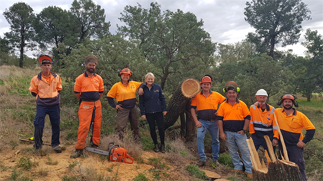 Staff from Copeton Waters, Lake Glenbawn and Lake Keepit at Lake Keepit doing Chainsaw training in a tricky spot on the side of a hill_s.jpg
