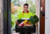 Coles Online team member Tom at customer's door (Small).jpg