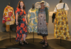 Carlyndal Slight di Tullio (QUT Student Designer) and Daisy Hamlot (Hopevale Fabric Designer) with garments designed as part of the couture collaboration on display at artisan (Bowen Hills).jpg