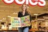 Coles CMO Lisa Ronson with Coles Little Treehouse book series (Custom).jpg